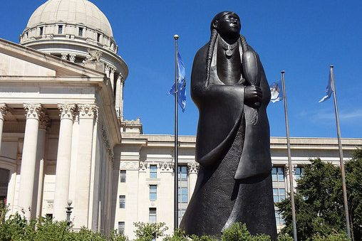 Statue of Native American woman in front of the Oklahoma State Capitol building