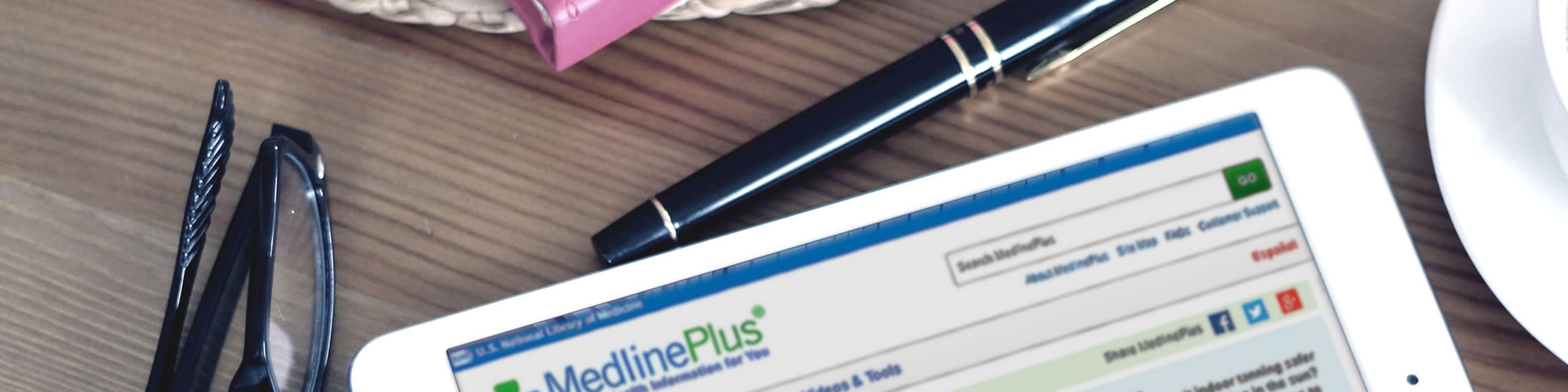 tablet showing medline plus website on screen